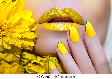 Yellow manicure and makeup.
