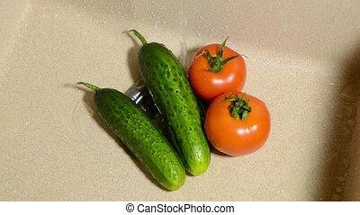 Wash fresh vegetables in sink under running water