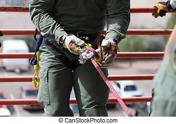 Learning The Ropes - Rope Rescue student preparing to rappel...