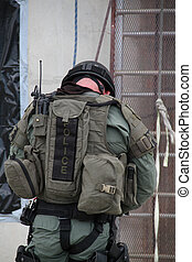 Gear Check - SWAT Cop double checks his gear after a rappel