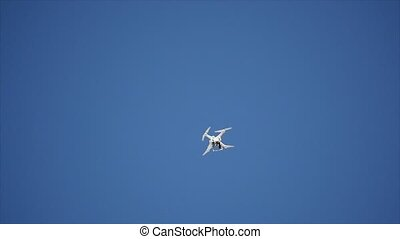 Professional Camera Drone flying in clear blue Sky