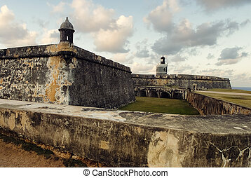 View of El Morro Fort with sunset sky, San Juan, Puerto Rico