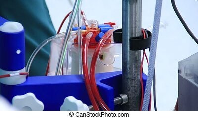 Heart lung machine pumping blood in operating room - Basic...