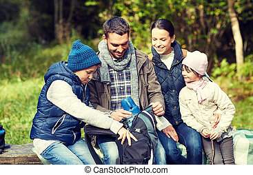 happy family with backpack and thermos at camp - camping,...