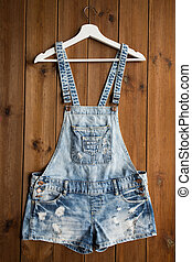 denim or jeans overalls with hanger on wood - clothes, wear...
