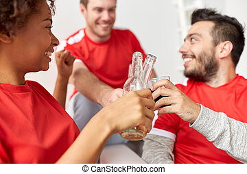 happy football fans or friends with beer at home - sport,...