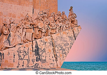 Stone ship shaped Monument to the Discoveries in Lisbon Portugal at sunset
