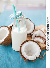 Coconut milk and fresh coconuts - Vintage bottle of coconut...