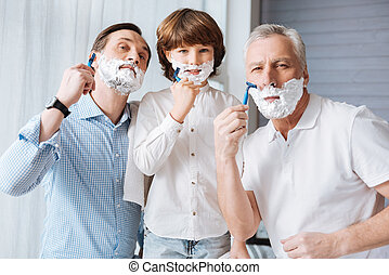 Nice delighted family shaving together - Time with family....