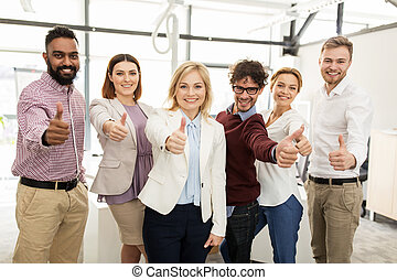 happy business team showing thumbs up at office - business,...