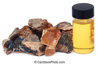 Frankincense dhoop with essential oil in a bottle