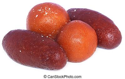 Popular Bangladeshi Sweetmeats Pantua and Kalojam over white...