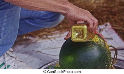 Man Pours Golden Powder to Watermelon on Counter in Vietnam...