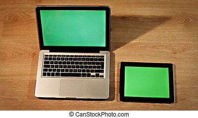 Top view female hand using touchpad on laptop and tablet screen