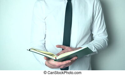 Businessman looking through his diary - Closeup of young...