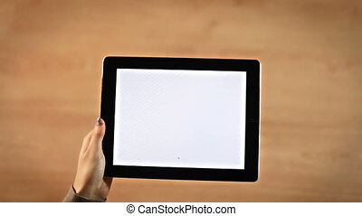 Top view female hands drawing equals symbol on digital tablet