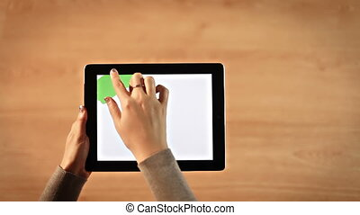Top view female hands drawing chroma key on digital tablet