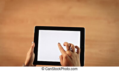 Top view female hands drawing heart om tablet