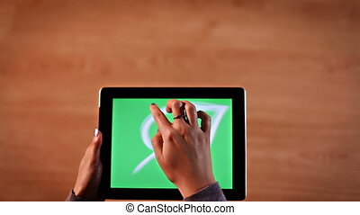 Top view female hands writing Save the planet, calligraphy on digital tablet