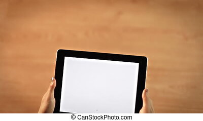 Top view female hands drawing at sign symbol on digital tablet