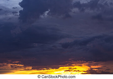 Romantic sunset sky with fluffy clouds and beautiful heavy...