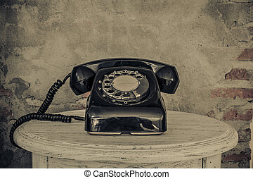Vintage black phone on old walls background for text and...