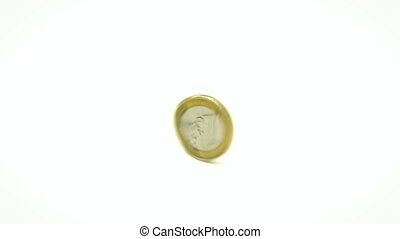 One Euro coin in rotation. Isolated on white background.