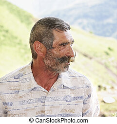 Elederly man with moustaches profile view - Elderly man with...