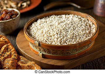 Israeli Couscous - A bowl of raw organic Israeli couscous.
