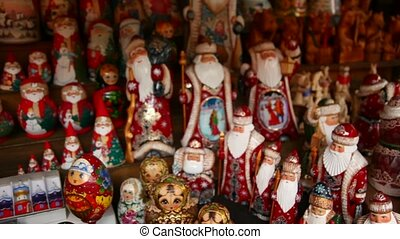 Many souvenir Russian wooden dolls, which are called Matryoshka and figures of Father Frost