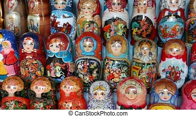 Many souvenir Russian wooden dolls, which are called Matryoshka are on counter in shop