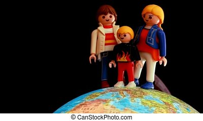Toy family is located on a rotating globe