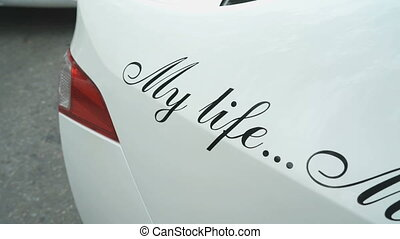 Inscription on rear wing of car: My life My rules -...