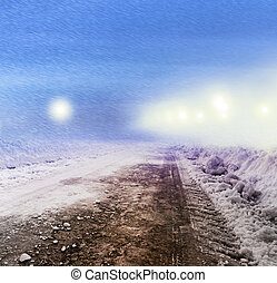 Snow covered road at night - Snow covered winter road with...
