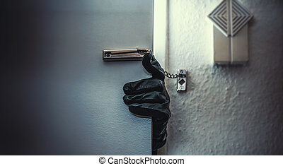 burglar - masked burglar with crowbar breaking and entering...