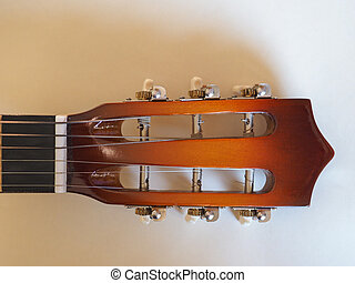 acoustic guitar stringed instrument - head and neck of an...