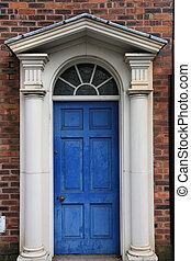 Georgian door - Birmingham. Old brick building and blue...