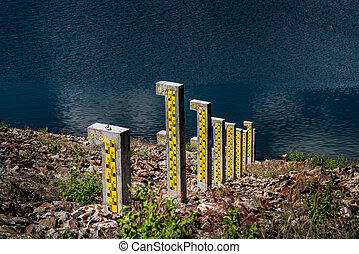 Water level pole at reservoir