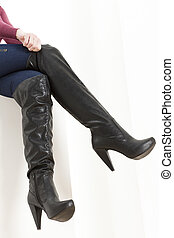 woman wearing fashionable boots