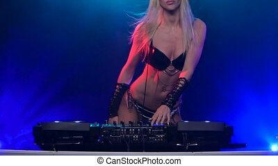 Hot woman DJ playing on vinyl records to rhythmic music -...