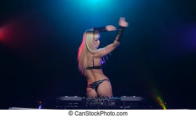 Blonde DJ woman sexy dancing for mixing console - Blonde dj...