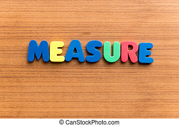 measure colorful word - measure colorful word on the wooden...