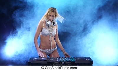 DJ woman in the smoke plays two songs. Smoky studio - DJ...
