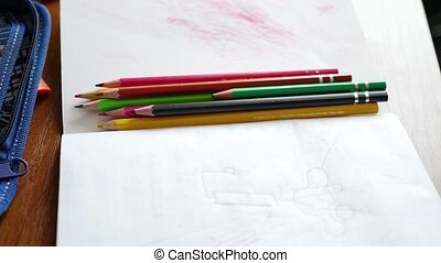 a child draws with colored pencils. 4 video in 1