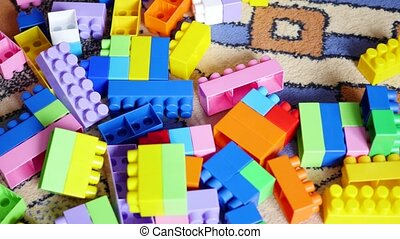 A young child plays in the constructor. Game of the children's designer. Colored cubes. 3 video in 1