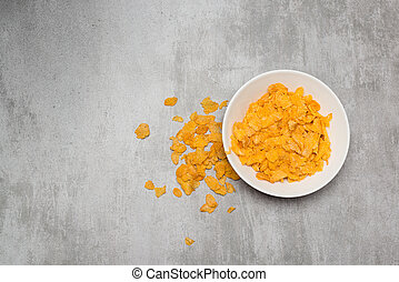 Corn flakes in a bowl on concrete table - Cornflakes cereal...