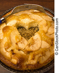 Apple pie with a hollow heart-shaped and two forks entwined...