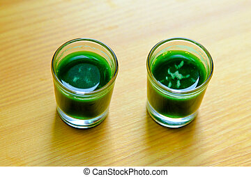 Wheatgrass shots - Two shoots of organic wheatgrass green...