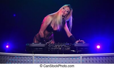 Erotic girl DJ. Slow motion - Erotic girl dj playing on...