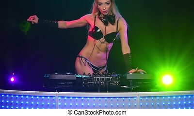 Woman DJ downmixes music and sexy moves to the beat